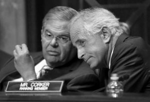 SENATE FOREIGN RELATIONS Committee Chairman Sen. Robert Menendez, left, D-N.J., talks with ranking member Sen. Bob Corker, R-Tenn., on Capitol Hill in Washington in this July 29 file photo. In the Senate Foreign Relations Committee, Menendez and Corker say they'll draft a bill in the lame-duck session repealing what they call outdated authorizations for the use of force and replace them with a new one.