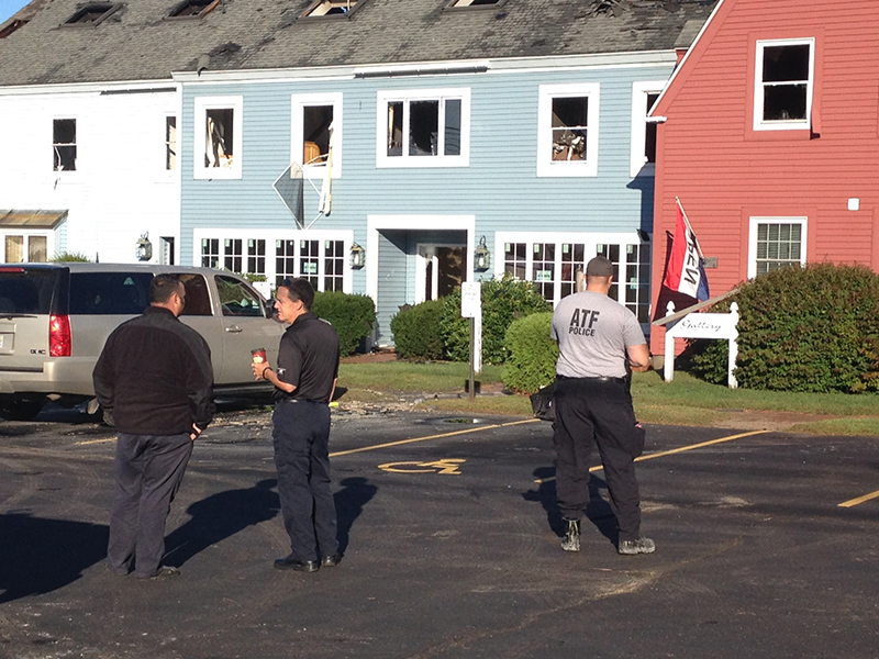 Members of the state Fire Marshal's Office and federal Bureau of Alcohol, Tobacco, Firearms and Explosives begin investigation of Monday night's fire at Scarborough Commons Tuesday. John Patriquin / Staff Photographer