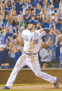 KANSAS CITY'S Eric Hosmer celebrates after scoring on a single by Christian Colon during the 12th inning of the AL wild-card playoff baseball game against the Oakland Athletics on Tuesday in Kansas City, Mo. The Royals will face the Los Angeles Angels of Anaheim in the Divisional round beginning on Thursday.