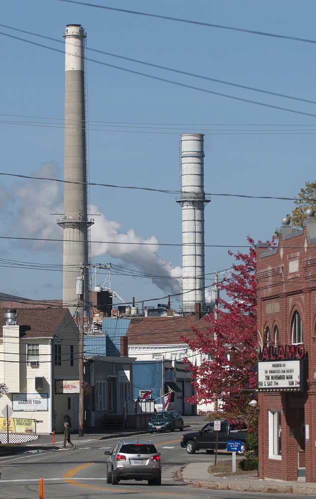 The Verso Paper mill's smokestacks loom over the town of Bucksport on Thursday, one day after Verso announced it will close the mill Dec. 1.