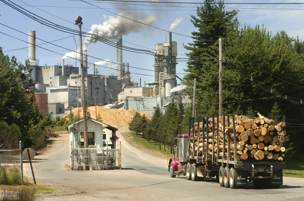 Logs are delivered to the Androscoggin Mill in Jay in 2005.