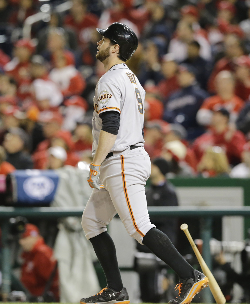 Brandon Belt of the San Francisco Giants watches the flight of the ball Saturday night. He hit a home run in the 18th inning that defeated the Washington Nationals 2-1 for a 2-0 series lead.