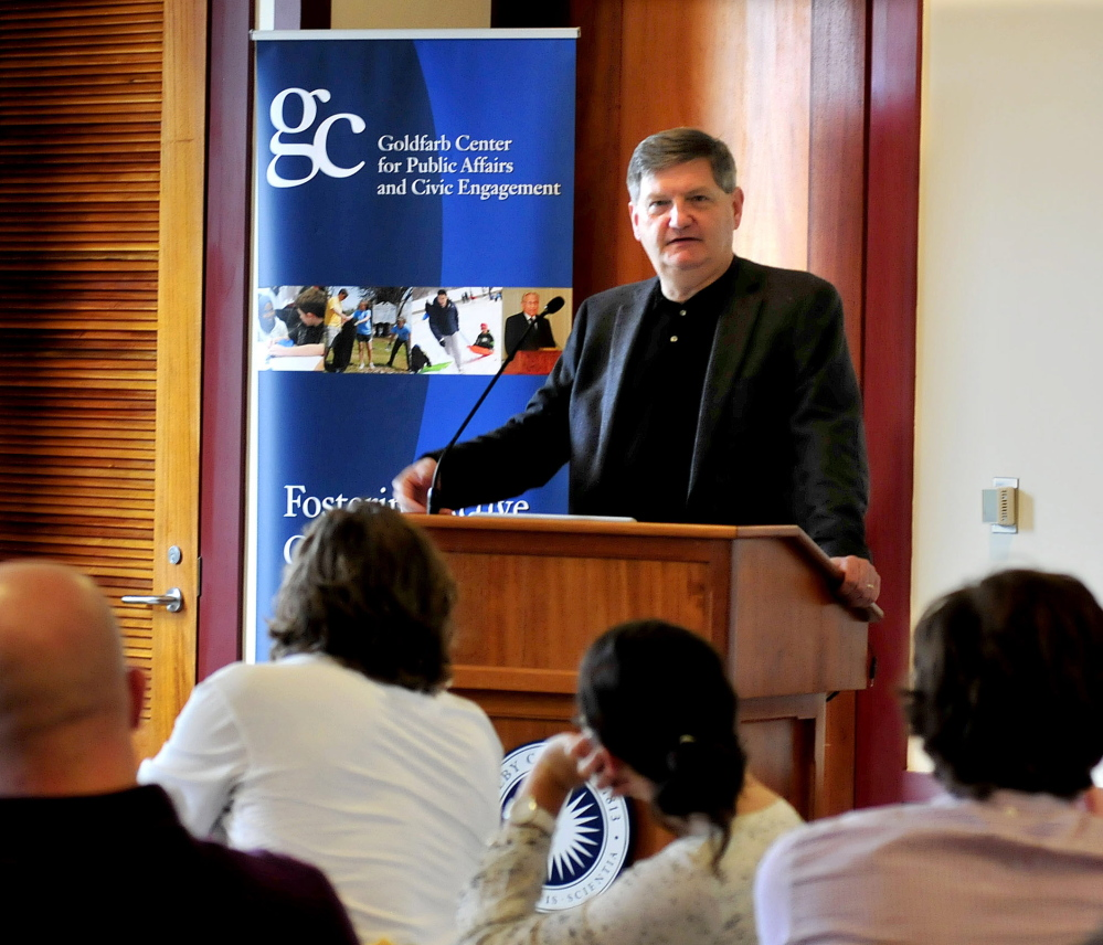 New York Times reporter James Risen speaks with students Sunday at Colby College in Waterville. Risen is this year's recipient of the Elijah Parish Lovejoy Award for courageous journalism.