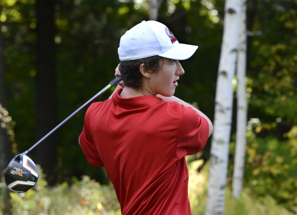 Scarborough High School golf team member Braeden Kane tees off during a high school match at Sable Oaks Golf Club in South Portland.