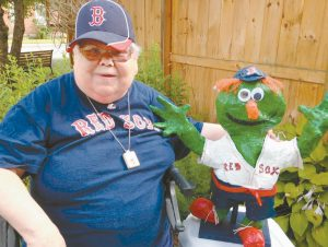 WHO'S GREEN, FUZZY, AND ROOTS FOR THE SOX, EVEN THIS YEAR? Wally the Green Monster, that's who. And Wally — and the Red Sox — are particular favorites of Spindleworks artist Helen Warren, so much so that she made her own sculpture of the Sox mascot. Warren lives at the Highlands, and it is there she'll be visited by the real Wally on Oct. 8 to accept the sculpture and take it back to his lair behind the scoreboard.