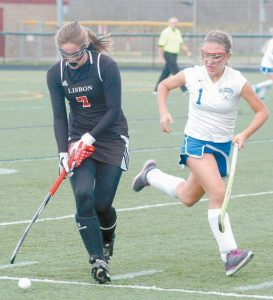 LISBON'S Molly Nicholson (7) is about to make a pass with Oak Hill's Heather Hannigan (1) closing in.