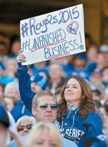 A ROYALS FAN displays a sign of support during the Season Celebration by the Kansas City Royals for the community on Thursday at Kauffman Stadium in Kansas City, Mo.