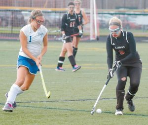 LISBON FIELD HOCKEY player Courtney Lawrence (3) and her Greyhound teammates compete Saturday in the Class C State Championship at Thomas College in Waterville on Saturday.