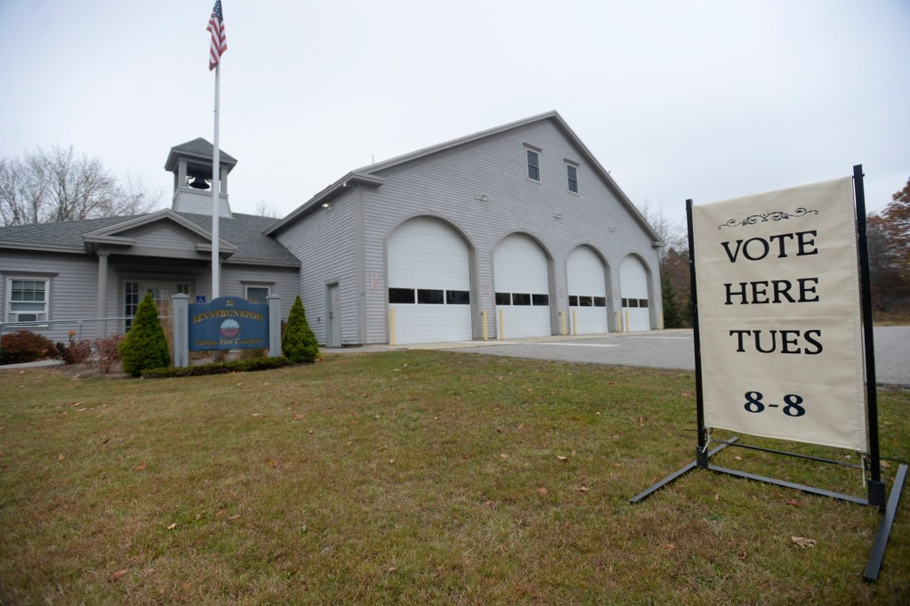 """Kennebunkport Village Fire Station with a """"vote here Tues(day)"""" sign out front. This year, voters across Maine will have a chance to sign a petition to change our election practices to better manage three-way races."""