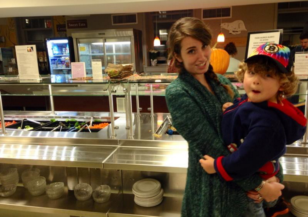 Baby sitter Nicole Smith, Bowdoin College class of 2016, with the author's son, Theo. Smith takes Theo to a Bowdoin dining hall while his parents grab a precious hour for a midweek date.