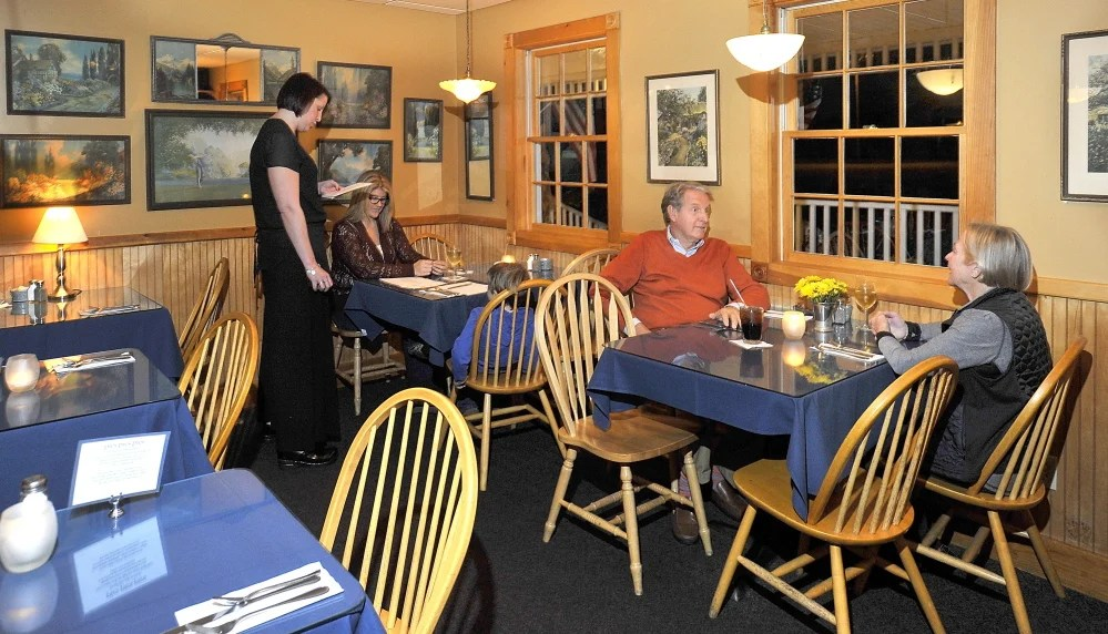 Above: Waitress Meghan Nannery takes the orders of Jessica Simpson and her son, Carter, 5, at The Good Table in Cape Elizabeth as Paul and Karen Robinson await their meals. The restaurant offers locally sourced food by season and meals ranging from your basic burger to a few offerings from Greece. Left: Beef Osso Bucco, a special at The Good Table, is made from red wine braised beef osso bucco, served with roasted local turnip and mashed local red potatoes topped with gremolata.