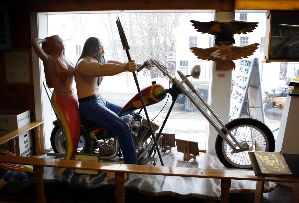 A life-size wood carving is displayed in the front window of the Maine State Prison store in Thomaston. The prison system also has a store in Windham that sells the handicrafts of inmates – everything from cutting boards to Adirondack chairs.
