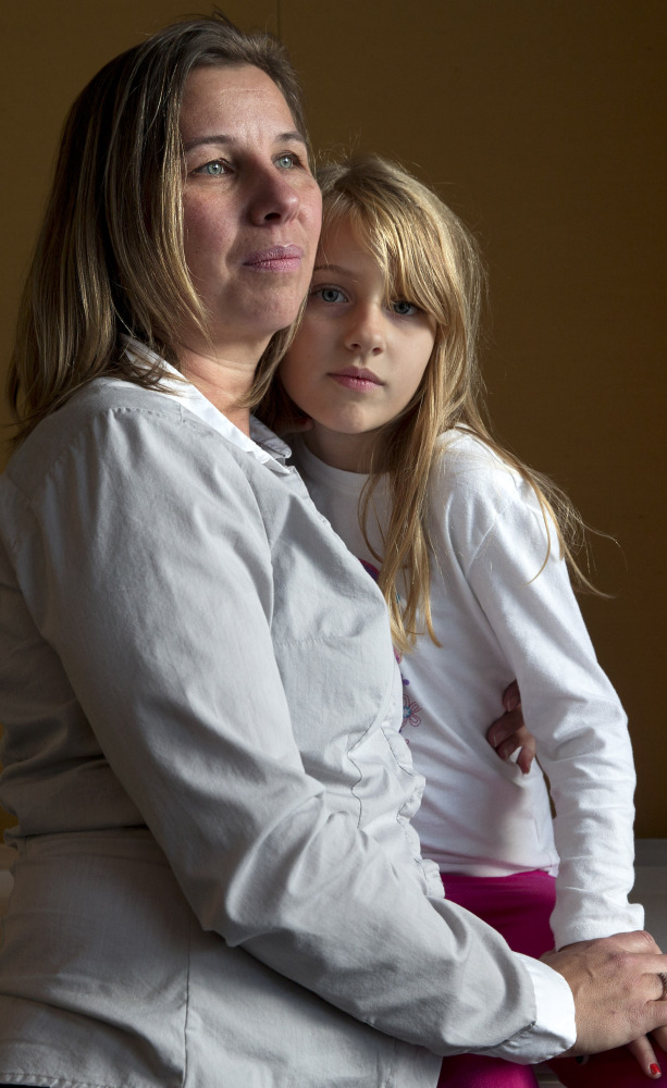 Peggy Young of Lorton, Va., holds her 7-year-old daughter, Triniti. The Supreme Court will hear her case Wednesday.
