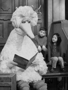 BIG BIRD reads to Connor Scott and Tiffany Jiao during a taping of the children's program