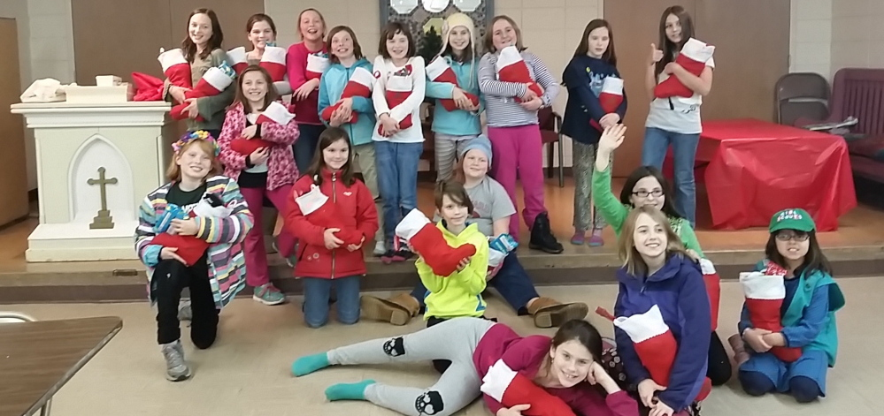 Members Portland Girl Scout Troop 1714 filled stockings for residents of the Preble Street Teen Shelter.