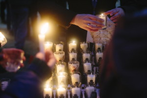 People light candles Monday in Portland at a vigil in Monument Square honoring the 35 members of the homeless community who died in 2014. Most of the people on the street are homeless for a short time, and many are families.