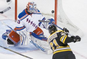 NEW YORK RANGERS GOALIE Cam Talbot (33) watches as a shot by Boston Bruins left wing Loui Eriksson passes the post for a goal during the third period of an NHL hockey game in Boston on Thursday.