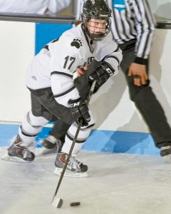 BOWDOIN COLLEGE women's hockey player Rachel Kennedy skates with the puck during a NESCAC game against MIddlebury on Saturday at Sidney J. Watson Arena. The Polar Bears fell, 5-3.