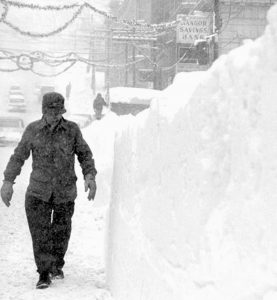 BELOW-FREEZING TEMPERATURES and high winds made even walking difficult in downtown Bangor when a record-breaking blizzard hit the area on Dec. 30, 1962. It snowed 25 inches in 24 hours and buried downtown Bangor in 6- to 10-foot drifts.