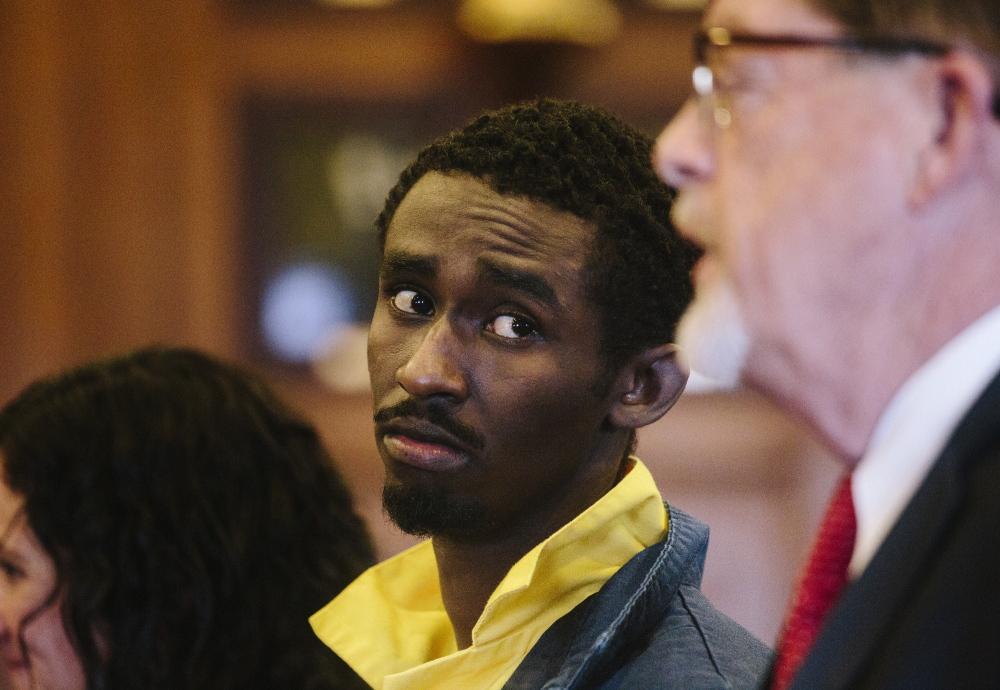 Abdirahman Huessin Haji-Hassan looks at his defense attorney Clifford Strike while he speaks to Justice Nancy Mills at his first appearance Thursday in Portland to face a murder charge in the killing of Richard Lobor in November.
