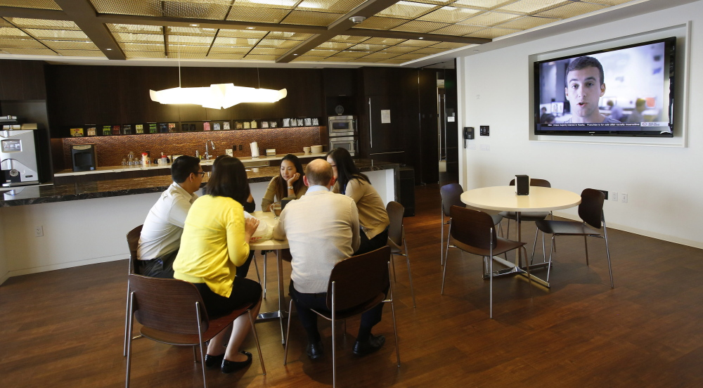 "Lawyers eat lunch at the law firm Morrison & Foerster, which has scaled back its library to create a communal hang-out space called the ""loungebrary"" in Los Angeles."