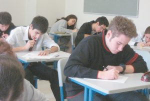 HIGH SCHOOL STUDENTS take an exam.