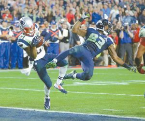 NEW ENGLAND PATRIOTS strong safety Malcolm Butler (21) intercepts a pass intended for Seattle Seahawks wide receiver Ricardo Lockette (83) during the second half of Super Bowl XLIX on Sunday in Glendale, Ariz.
