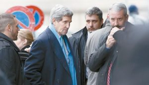 U.S. SECRETARY OF STATE JOHN KERRY, center, arrives at the hotel prior to a bilateral meeting with Iranian Foreign Minister Mohammad Javad Zarif for a new round of Nuclear Talks, in Geneva, Switzerland, Sunday, Feb. 22.