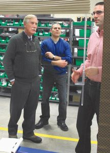 SEN. ANGUS KING, I-Maine, left, with RollEase Senior Vice President Greg Farr, center, and design engineer Michael Brown on Friday during a tour of Farr's company at Brunswick Landing.
