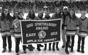 THE BRUNSWICK HIGH SCHOOL girls hockey team was awarded the 2015 Maine Principals' Association Sportsmanship Award for the East Conference Saturday during the state title game between Lewiston and Falmouth at the Androscoggin Bank Colisee. Accepting the award were players (from left) Jordan Van Savage, Aidan Crawford, Emily Yuodsnukis, Victoria Stevens, Autumn Thoits, Tessa Cassidy, Adele Wise, Caitlyn Olson and Amy Hogan, accompanied by head coach AJ Kavanaugh. The award is voted on by all the teams in the conference and is the first MPA Sportsmanship Award the Lady Dragons have earned in their brief history.