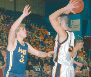 HYDE'S FREDERIK LASSON (32) guards Forest Hills forward Tanner Daigle (54) at the Augusta Civic Center on Saturday.
