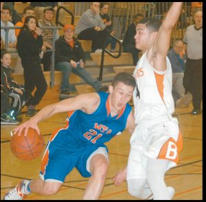 MT. ARARAT EAGLE SHY ULRICKSON (21) makes a break for the basket against Brunswick's Taran Payne during Thursday's Kennebec Valley Athletic Conferece contest at Brunswick High School. Urlrickson, who had 32 points, and Mt. Ararat captured the 66-56 victory.