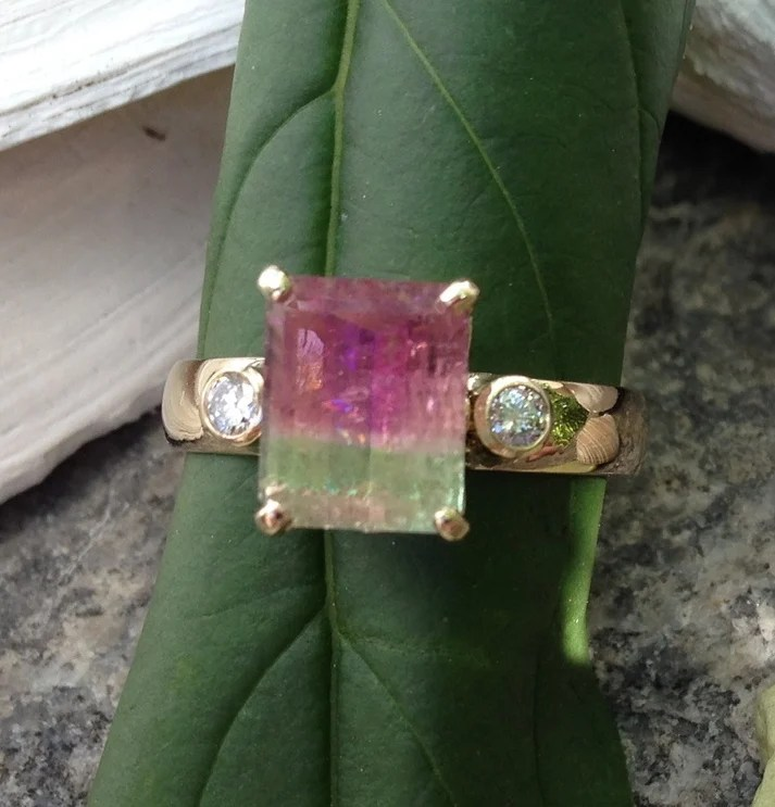 The upside of a ring with a watermelon tourmaline center stone is it speaks of Maine. The downside is the stone is not as durable as harder ones, such as diamonds.