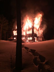 Fire trucks couldn't get through a snow-filled driveway to fight a fully involved structure fire that destroyed a home Tuesday night at 190 Hedge Bridge Road in Woolwich. PHOTO COURTESY OF WOOLWICH FIRE DEPARTMENT