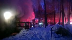 Smoke billows from a house which caught fire due to an electrical problem at 508 Browns Point Road in Bowdoinham Wednesday night. PHOTO COURTESY OF BOWDOINHAM FIRE DEPARTMENT