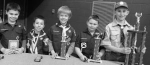 FROM LEFT TO RIGHT, Damien Hale, 10, won best of show; Aidan Fisette, 8, won fourth place; Alex Skolfield, 9, won third place; Chase Hardee, 7, won second place and Grady Satterfield, 11, won the first place trophy during Bowdoinham Cub Scout's Pinewood Derby Saturday held at Bowdoinham Community School.