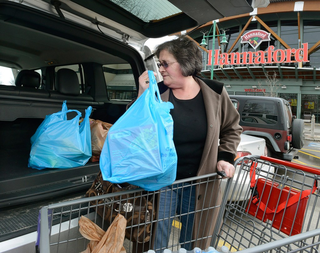 Joan Cushman of Portland loads groceries into her car at Hannaford's Forest Avenue store, which will charge for plastic bags after a city ordinance takes effect April 15. Hannaford's Portland stores will give out reusable bags from March 29 through April 14.