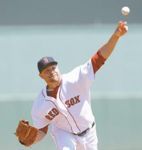 BOSTON PITCHER and former Portland Sea Dog Brian Johnson delivers against the Tampa Bay Rays in the first inning during an exhibition spring training baseball game on Sunday in Fort Myers, Fla.