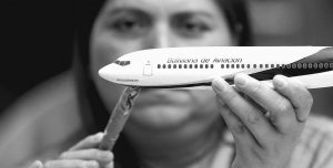 DIOCELINA BARAJAS APPLIES DECALS to a model plane at Pacific Miniatures in Fullerton, Calif. When airlines open new routes, make deals with other carriers or finance new jets, there is a gifting of high-quality models. They are used to break the ice at difficult meetings, are tremendous marketing tools and a favored way of saying thank you.