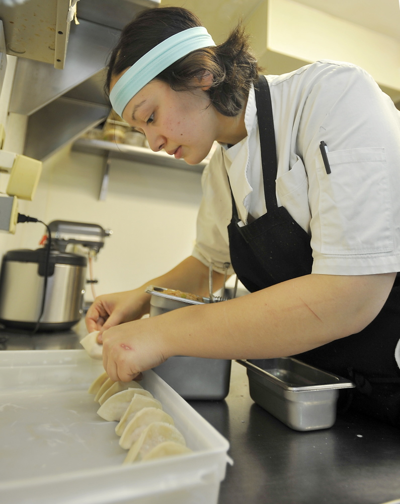 """Cara Stadler, chef and co-owner of Tao Yuan in Brunswick and Bao Bao Dumpling House in Portland, says she loves """"the insanity of the kitchen."""""""