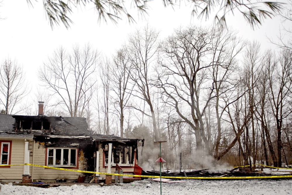 The home of Rodger and Diane Tullos on West Lebanon Road in Lebanon was still smoldering Friday morning after an early-morning five-alarm fire started in the barn and spread to the back of the house.