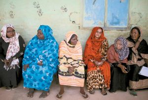 SUDANESE WOMEN wait for their turn to vote outside a polling station, on the first day of Sudan's presidential and legislative elections, in Izba, an impoverished neighborhood on the outskirts of Khartoum, Sudan, in this April 13 file photo.