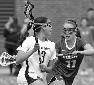 BOWDOIN COLLEGE JUNIOR Lindsay Picard (3) looks for an open teammate over the shoulder of defending Abby Hatch (11) of Colby. The Polar Bears edged the Mules, 12-11 in the NESCAC quarterfinals on Saturday.