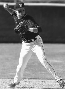 POLAR BEARS SHORTSTOP Sean Mullaney attempts to throw a runner out during a contest against Colby this past weekend.