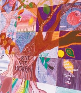 PICTURED IS THE community wall in the Family Crisis Services' shelter dining room featuring the hope tree created by women and girls participating in support groups.