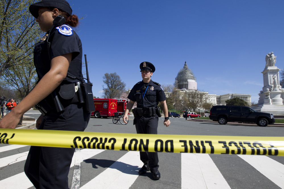 U.S. Capitol Police officers work a perimeter at the U.S.  Capitol in Washington on Saturday.