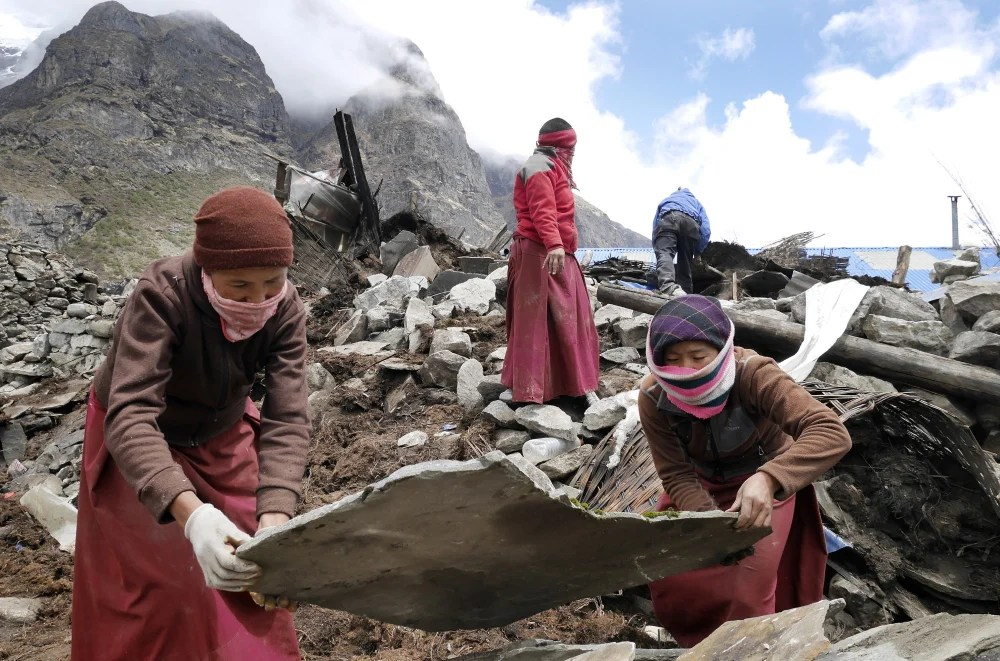 """Nuns from a monastery in the decimated village of Thame assist in the recovery effort Wednesday. """"Life in these villages is hard, harsh and often deadly,"""" said Portland's Doug Bruns."""