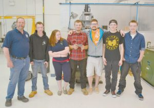 REGION TEN TECHNICAL HIGH SCHOOL has partnered with Southern Maine Community College on a composites program. Pictured, from left, are instructor Robert Turcotte, Cameron Balzer, Kayla Thatcher, John Curit, Lab Assistant Drew Sfirri, Dylan Thiboutot and Jake Hayward. (Not pictured are Austin Dodge, Isaac Hughes, Nate Sprague and Riva Stein.)