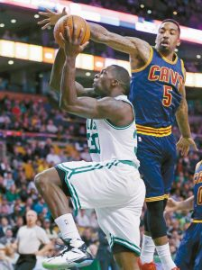 CLEVELAND CAVALIERS GUARD J.R. Smith (5) tries to strip the ball from the grip of Boston Celtics forward Brandon Bass (30) on a drive to the basket during the first quarter of a firstround NBA playoff basketball game in Boston on Thursday.