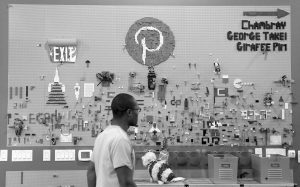 A PINTEREST EMPLOYEE walks past the Lego wall at the Pinterest office in San Francisco in this Nov. 13, 2014 photo. The San Francisco-based venture capital darling celebrated its fifth birthday in March 2015.